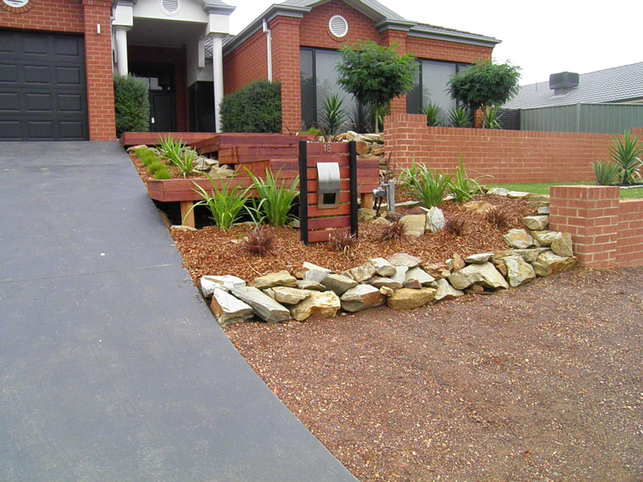 Sandstone landscaping rocks castlemaine landscaping with for Domestic garden ideas